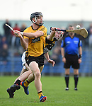 John Conlon of Clonlara in action against Joe Neylon of Ballyea during their senior county final replay at Cusack Park. Photograph by John Kelly.