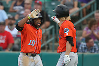 Sherman Johnson #10 of the Inland Empire 66ers is greeted by teammate Chad Hinshaw #6 after scoring during a playoff game against the Lancaster JetHawks at The Hanger on September 7, 2014 in Lancaster, California. Lancaster defeated Inland Empire, 5-2. (Larry Goren/Four Seam Images)