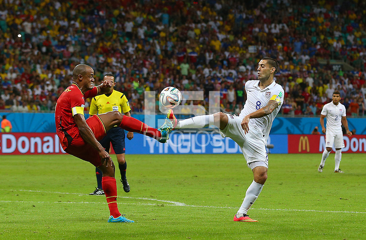 Vincent Kompany of Belgium and Clint Dempsey of USA in action