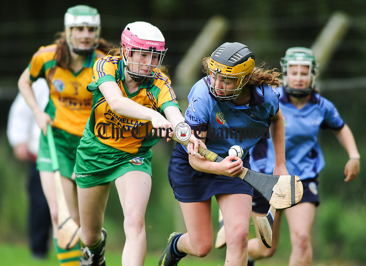 Jane Fitzgerald of Inagh-Kilnamona in action against Louise Egan of Truagh-Clonlara during their first round senior championship game in Shannon. Photograph by John Kelly