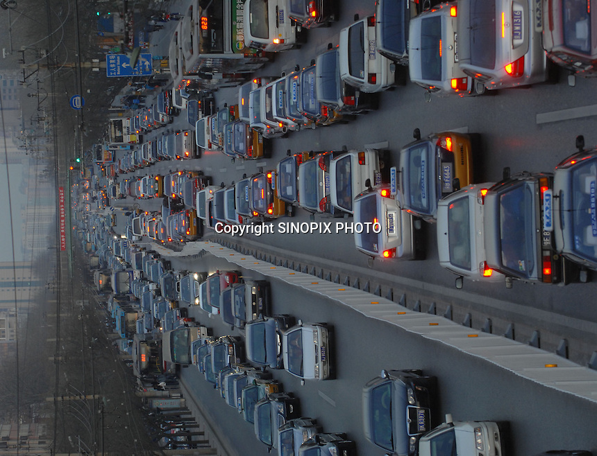 Some of Beijing's 3.1 million cars during evening rush hour.  One thousand new cars are added to Beijing's roads each day massively adding to the pollution problems.