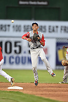 Lowell Spinners shortstop Mauricio Dubon (7) throws to first during a game against the Batavia Muckdogs on July 18, 2014 at Dwyer Stadium in Batavia, New York.  Lowell defeated Batavia 11-2.  (Mike Janes/Four Seam Images)