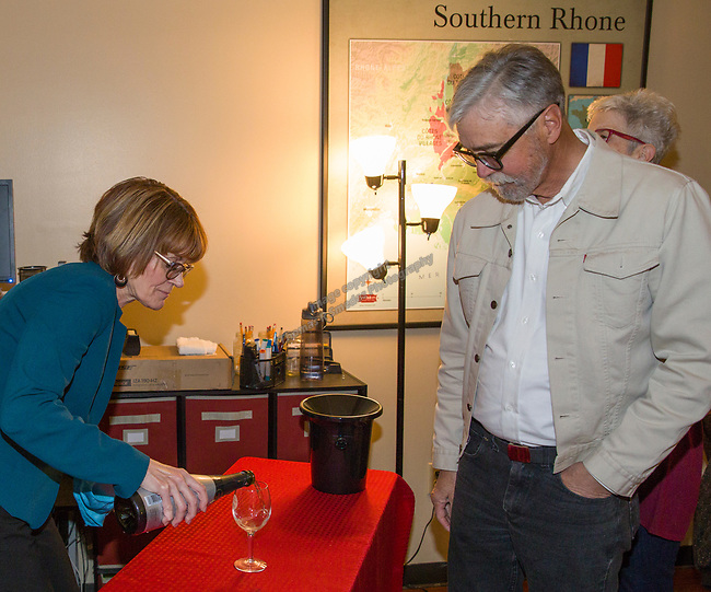 "Rebecca Davidson pours wine for Richard Breitling during the Reno Magazine ""Bubbles Tasting"" event at Total Wine in Reno on Friday night, February 9, 2018."