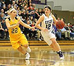 SIOUX FALLS, SD, FEBRUARY 10:  Kaely Hummel #12 from the University of Sioux Falls drives against Lynsey Prosser #22 from Augustana Friday night at the Stewart Center in Sioux Falls. (Photo by Dave Eggen/Inertia)