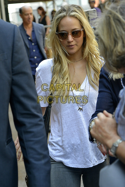NEW YORK, NY - JUNE 26: Jennifer Lawrence seen checking out the penthouse apartment right next to Jay Z and Beyonce's building with her parents on June 26, 2015 in New York City. <br /> CAP/MPI/mpi67<br /> &copy;mpi67/MPI/Capital Pictures