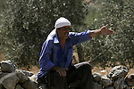 Israeli soldiers prevent Palestinian farmers and Israeli settlers from fighting after a farmer was wounded by Israeli settlers from the Bracha settlement who were trying to collect olives from Palestinian land, on Sept. 20, 2010 in the West Bank village of Burin . Photo by Wagdi Eshtayah