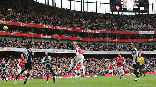 17.11.2012. London, England. Premiership football from The Emirates Arsenal versus Tottenham Hotspur. Arsenal's Per Mertesacker scores his sides equalising goal to make the score 1:1