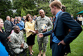 Prince Harry greets U.S. wounded warriors during a reception at the British Ambassador's Residence in Washington, D.C. on May 7, 2012.  .Credit: Kevin Dietsch / Pool via CNP