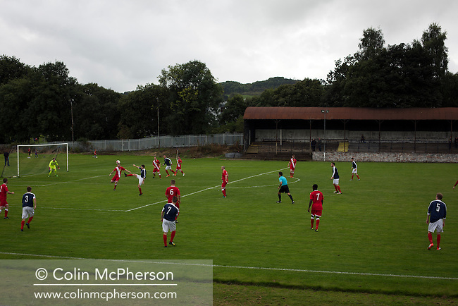 Second-half action at Millburn Park, Alexandria, as Vale of Leven (in blue) hosted Ashfield in a West of Scotland League Central District Second Division Junior fixture. Vale of Leven were one of the founder members of the Scottish League in 1890 and remained part of the SFA and League structure until 1929 when the original club folded, only to be resurrected as a member of the Scottish Junior Football Association after World War II. They lost the match to Ashfield by 4-3, having led 3-1 with 10 minutes remaining.