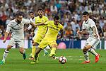 Real Madrid's Daniel Carvajal an James Rodriguez and Villarreal's Bruno Soriano during the match of La Liga between Real Madrid  and Villarreal Club de Futbol at Santiago Bernabeu Estadium in Madrid. September 21, 2016. (ALTERPHOTOS/Rodrigo Jimenez)