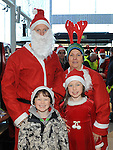 Three family generations, Neill Kelly pictured with his mother Martina and children Rosie and Connor who took part in the Santa Run at Scotch Hall. Photo: Colin Bell/pressphotos.ie