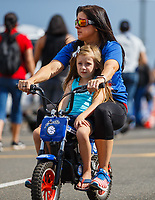 Jul 23, 2017; Morrison, CO, USA; NHRA pro stock motorcycle rider Angelle Sampey with daughter Ava Drago during the Mile High Nationals at Bandimere Speedway. Mandatory Credit: Mark J. Rebilas-USA TODAY Sports