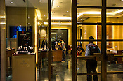 Shoppers seen inside the luxury watch store in Pavilion, a high end shopping mall in Kuala Lumpur, Malaysia.