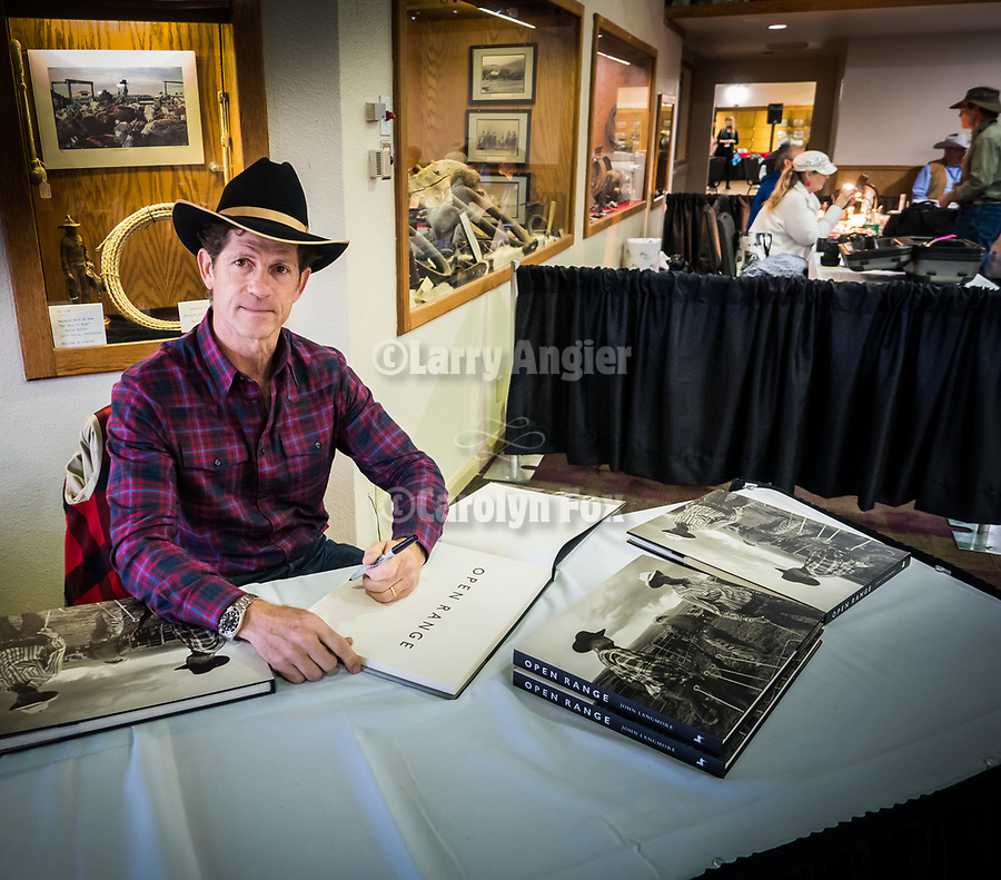 John Langmore signs his Open Range book, Friday symposium at STW XXXI, Winnemucca, Nevada, April 12, 2019.<br /> .<br /> .<br /> .<br /> .<br /> @shootingthewest, @winnemuccanevada, #ShootingTheWest, @winnemuccaconventioncenter, #WinnemuccaNevada, #STWXXXI, #NevadaPhotographyExperience, #WCVA
