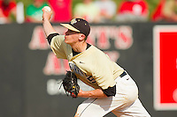 Wake Forest Demon Deacons relief pitcher Jack Fischer #15 delivers a pitch to the plate against the North Carolina State Wolfpack at Doak Field at Dail Park on March 17, 2012 in Raleigh, North Carolina.  The Wolfpack defeated the Demon Deacons 6-2.  (Brian Westerholt/Four Seam Images)