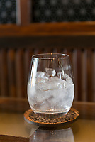 A glass of shochu, Nekka Shochu Distillery, Tadami, Fukushima, Japan, February 22, 2018. The Nekka shochu distillery was founded in July 2016 and at that time was the smallest shochu distillery in Japan. It makes shochu from locally-grown rice, and is helping support a local economy that has languished since the nuclear disaster of 2011.