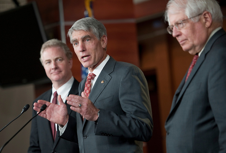 "UNITED STATES - JUNE 19: From left, Rep. Chris Van Hollen, D-Md.; Sen. Mark Udall, D-Colo.; and Rep. David Price, D-N.C., hold a news conference on H.R.414, the ""Presidential Funding Act,"" a proposal to overhaul the presidential campaign public financing system. (Photo by Chris Maddaloni/CQ Roll Call)"