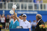 Colm McLoughlin CEO Dubai Duty Free presents the winner Russell Knox (SCO) with the trophy at the end of Sunday's Final Round of the 2018 Dubai Duty Free Irish Open, held at Ballyliffin Golf Club, Ireland. 8th July 2018.<br /> Picture: Eoin Clarke   Golffile<br /> <br /> <br /> All photos usage must carry mandatory copyright credit (&copy; Golffile   Eoin Clarke)