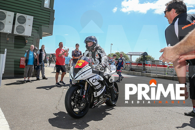 Tim Neave of the Neave Twins team (No. 14) comes into the winner's enclosure after winning the Pirelli National Superstock 600 Championship race at Round 5 of the 2017 MCE British Superbikes Championship  at Snetterton Circuit, Norwich, England on 2 July 2017. Photo by David Horn.