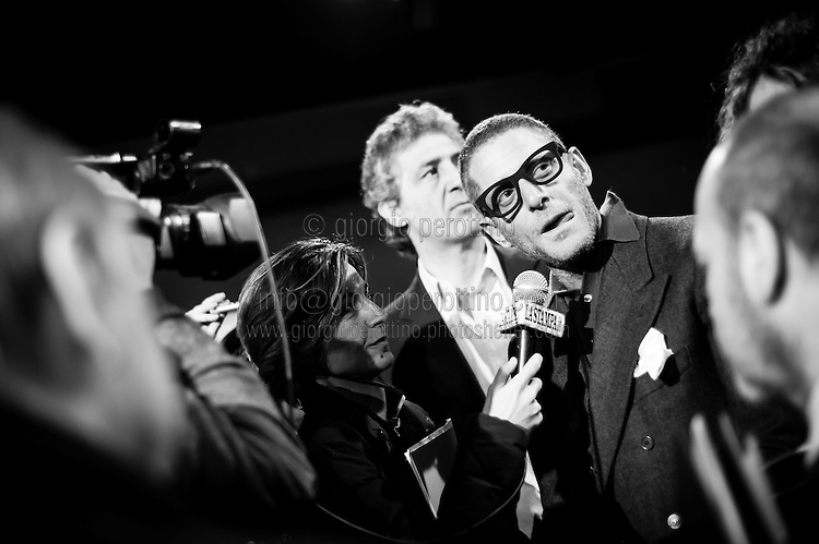 Lapo Elkann talks with journalists as he visits the exhibition of his Grandfather Giovanni Agnelli's cars at the Car Museum of Turin, Italy, March 12, 2013.
