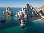 Sea of Cortez, Cabo San Lucas, Mexico; an aerial view of Lands End and the Arch of Cabo San Lucas in early morning sunlight, these rocks at the southern most end of the Baja Peninsula separate the Sea of Cortez from the Pacific Ocean
