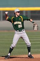Jake Miller #20 of the Baylor Bears makes a throw against the UCLA Bruins at Jackie Robinson Stadium on February 25, 2012 in Los Angeles,California. UCLA defeated Baylor 9-3.(Larry Goren/Four Seam Images)