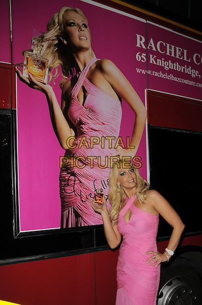 "LIZ FULLER.The ""Dream de Rachel Elbaz"" new perfume launch, Rachel Boutique, Knightsbridge, London, England..December 9th, 2008.fragrance half length 3/4 pink dress drop waist halterneck hand on hip bottle.CAP/CAN.©Can Nguyen/Capital Pictures."