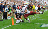 17 September 2016:  Penn State QB Trace McSorley (9) dives to the pylon and across the goal line for a touchdown while Temple LB Jarred Alwan (41) hits him. The Penn State Nittany Lions defeated the Temple Owls 34-27 at Beaver Stadium in State College, PA. (Photo by Randy Litzinger/Icon Sportswire)
