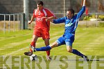 Tralee Dynamos Theo Diggins and Limerick F.C.'s Declan Cahill.