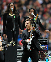 London, England. McFly Reunited! After Harry Judd winning Strictly Come Dancing and Dougie Poynter being crowned King of the Jungle the boys reunite to perform during the Saracens and Harlequins Aviva Premiership with a world record crowd of 83,761 for a club rugby match at Wembley Stadium. 31March 2012 at Wembley Stadium, London, England,