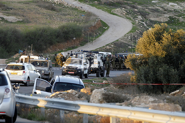 Israeli police inspect the scene after an Israeli car came under fire from an alleged passing Palestinian vehicle, near the Israel settlement of Athniel, south of the West Bank city of Hebron, 13 November 2015. Israel army report that two Israeli's were killed, a father and his son, and one injured when shots were fired at their vehicle near Hebron, the attacker fled the scene. Israeli forces are currently searching the area. Photo by Wisam Hashlamoun