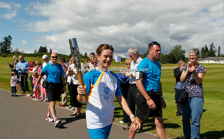 Baton bearer, Catriona Matthew carries the baton after it arrived by parachute at the venue for the 2014 Ryder Cup, Gleneagles Hotel as part of the Glasgow 2014 Queens Baton Relay : Picture Stuart Adams www.golftourimages.com: 5th July 2014