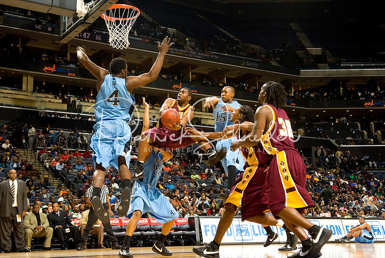 A basketball player shoots a basketball during the CIAA Tournament  in Charlotte, NC.