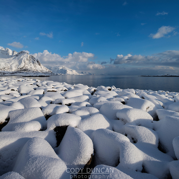 Snow covered rocks near coast, Hamnøy, Moskenesøy, Lofoten Islands, Norway