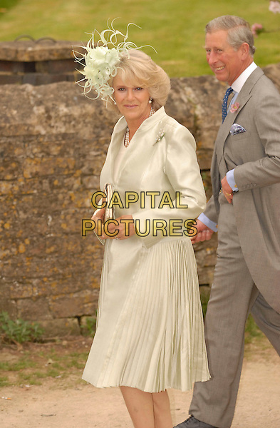 CAMILLA, DUCHESS OF CORNWALL & CHARLES, PRINCE OF WALES.At the wedding of Laura Parker Bowles and Harry Lopes at St Cyriac's Church, Lacock, Wiltshire, England, .6th May 2006..half length royal mother green gold satin dress coat feather hat bag married husband wife HRH.Ref: FIN.www.capitalpictures.com.sales@capitalpictures.com.©Steve Finn/Capital Pictures.