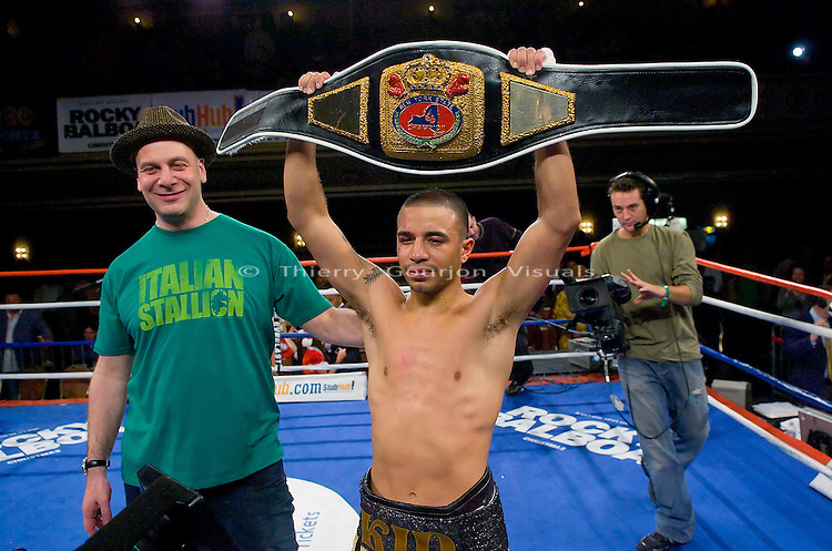Gary Stark Jr. (r) with promoter Lou DiBella, holds the NY State Junior Featherweight Championship belt after his fight  against Vernie Torres  at the Manhattan Center in N.Y.C on 12.14.06..Stark won by Unanimous decision.<br />