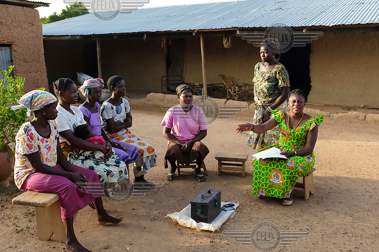 Anita Sutha, a junior high school teacher by profession, also coordinates a number of women's groups in her area. She is seen with members of a 'susu' group - an informal savings and loan club - that she coordinates in her home village of Gbengbee.