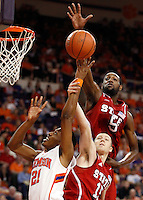 Clemson's Damarcus Harrison attempts a shot as N.C. State's Scott Wood and C.J. Leslie defend in the first half at Littlejohn Coliseum on Sunday.