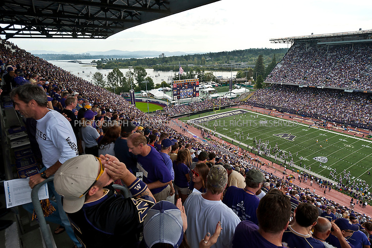9/24/2011--Seattle, WA, USA...Boats tied up at Husky Harbor can be seen at the far left, next to Husky Stadium...The 'Big Dawg', owned by Lisa and Tim Kittilsby, is the biggest, most prominent boat that attends regular boat tailgate parties on docks near the UW (University of Washington) Husky Stadium. Up to 500 boats will tie up outside Husky Stadium on football game days, ranging from from small boats to huge yachts. The Big Dawg is a 92-foot, two-story yacht that dominates the tailgate parties...The tradition started when Lisa and Tim Kittilsby's parents, Frank and Jeanie Miles, took a 23-foot boat called The Mixer to a game over 40 years ago...©2011 Stuart Isett. All rights reserved.