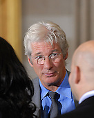 Washington, DC - October 17, 2007 -- Humanitarian and actor Richard Gere speaks with audience members as they await the arrival of The 14th Dalai Lama, Tenzin Gyatso, in the Rotunda of the United States Capitol in Washington, D.C. on Wednesday, October 17, 2007.  The Dalai Lama was at The Capitol to accept the Congressional Gold Medal, the nation's highest and most distinguished civilian award..Credit: Ron Sachs/CNP