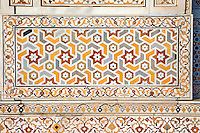 "Agra, India.  Pietra Dura Inlaid Stone Design, Itimad-ud-Dawlah, Mausoleum of Mirza Ghiyas Beg.  The tomb is sometimes referred to as the ""Baby Taj.""   It is one of the finest examples of pietra dura work, making designs through the use of inlaid colored stone."