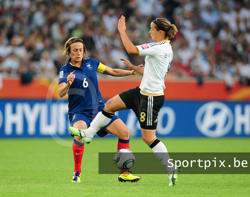 Fifa Women's World Cup Germany 2011 : France - Germany ( Frankrijk - Duitsland ) at Munchengladbach World Cup stadium : Sandrine SOUBEYRAND in duel met Inka GRINGS.foto DAVID CATRY / Vrouwenteam.be
