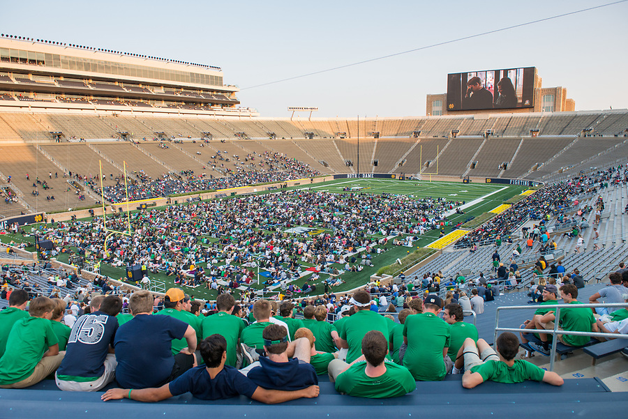 """August 26, 2017; Notre Dame welcomed students back to campus and opened the stadium to visitors for Flick on the Field, an open house event featuring a showing of """"Rudy"""" on the new video board.  (Photo by Barbara Johnston/University of Notre Dame)"""