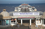 Pier and seafront, Cromer, Norfolk, England. Cromer is a traditional seaside resort town on the north coast of Norfolk. The Pavilion theatre is located at the end of the pier.