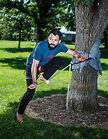 Working with experts at Rocky Mountain Slackline, Adventure columnist, Clint Carter practices slacklining at Spring Park in Ft. Collins, Colorado, Sunday, August 27, 2017. Carter take on a vertigo-inducing highline&nbsp;that stretches across a traverse after only 4 days of training.<br /> <br /> Photo by Matt Nager