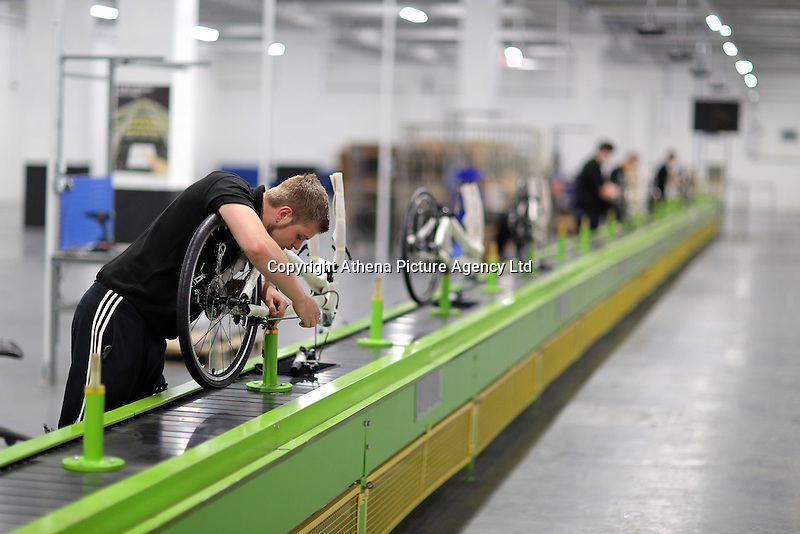 Pictured: Jack Appleby on the assembly line Monday 15 August 2016<br />Re: Frog Bikes in Mamhilad Estate Park in Pontypool, Wales, UK