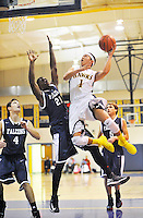 Highland's Logan Miller soars through the air to the basket past a Fredericksburg Academy defender during Highland's 70-28 win at Highland School in Warrenton, VA.  --Photo By Randy Litzinger