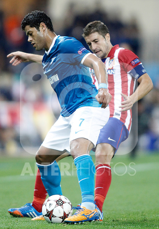 Atletico de Madrid's Koke (r) and Football Club Zenit's Hulk during Champions League 2013/2014 match.September 18,2013. (ALTERPHOTOS/Acero)