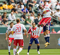 Chivas USA midfielder Sacha Kljestan (16) battles with NY RedBulls forward Macoumba Kandji (10). Chivas USA defeated the Red Bulls of New York 2-0 at Home Depot Center stadium in Carson, California April 10, 2010.  .