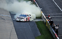 May 31, 2008; Dover, DE, USA; Nascar Nationwide Series driver Denny Hamlin celebrates in front of his crew after winning the Heluva Good 200 at the Dover International Speedway. Mandatory Credit: Mark J. Rebilas-US PRESSWIRE